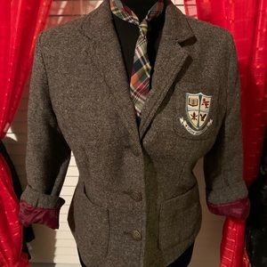 Tweed blazer with matching tie.
